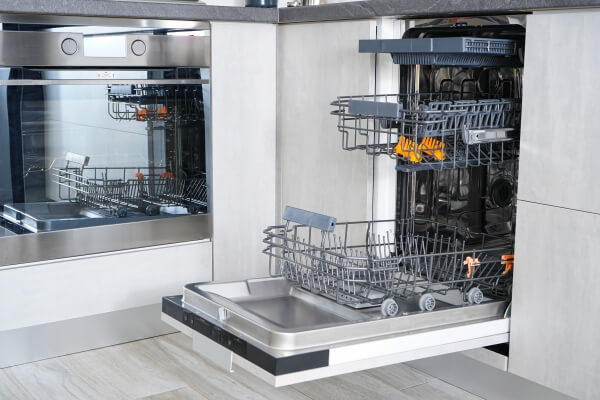 clean dishwasher with door open and racks slided